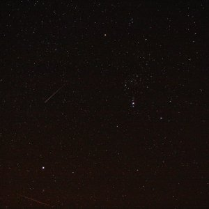 Orion from a dark side with some bonus meteors. Credit: Darren Baskill